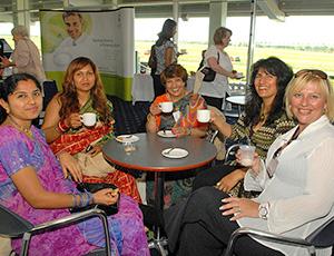 Ladies talking business over tea